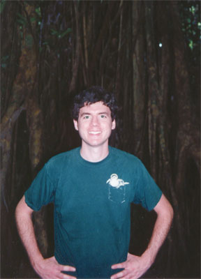 Photo of John in front of a strangler fig by Justin Hunter Dec 1996.