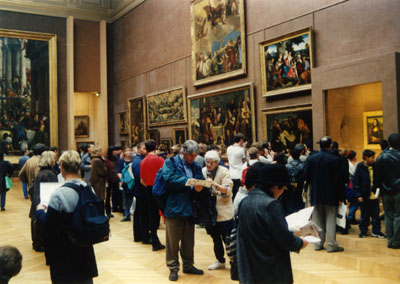 Photo in Mona Lisa room of the Louvre by John Hunter 1998