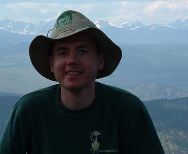 Photo of John Hunter on Mesa Trail with the Rocky Mountains in the background, 2003